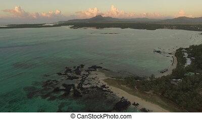 Blue lagoon and Mauritius coastline, aerial view - Aerial...
