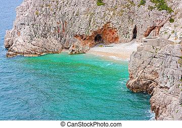 Blue lagoon in Adriatic Sea of Croatia. Island coastline.