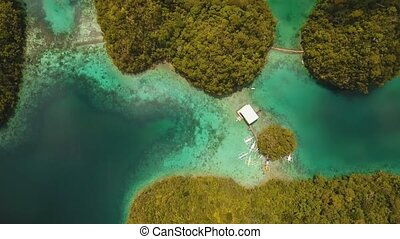 blue lagoon with islands - aerial footage cove with blue...