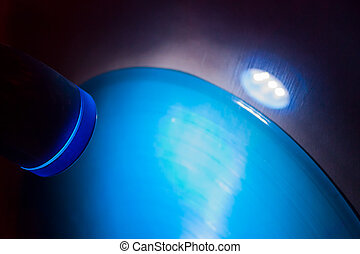 Blue lamp shining on vinyl record on wall in disco