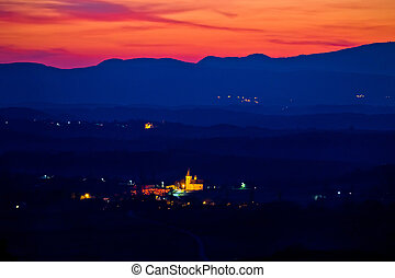 Blue landscape at red sundown in Prigorje region of Croatia,...