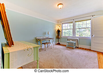 Blue large room as home office for fashion designer.