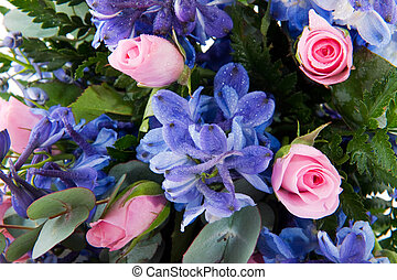 Blue larkspur and pink roses