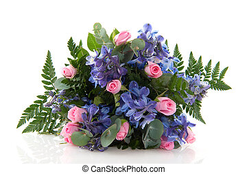 Blue larkspur and pink roses in bouquet