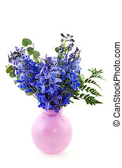 Blue larkspur in pink vase