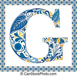 Blue floral capital letter G in frame made of Portuguese tiles