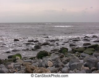 Blue Lias cliffs on Monmouth Beach, Lyme Regis - Pan from...