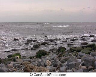 Blue Lias cliffs on Monmouth Beach, Lyme Regis - Pan from...