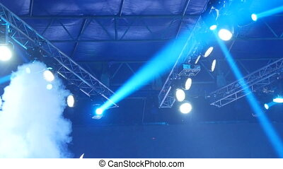 Blue light on the stage. Soffits shine at a concert....