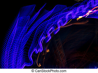 Blue lights in motion at night as an abstract background