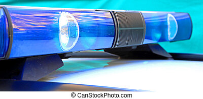 blue lights of the police car sirens