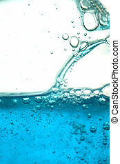 close up of blue liquid with bubbles