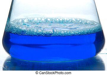 blue liquid in a retort