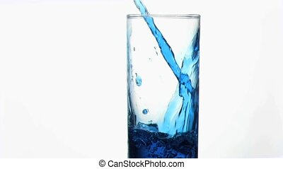 Blue liquid in super slow motion flowing in a glass