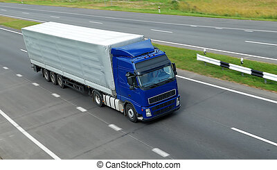 upper view of blue lorry with grey trailer on the highway