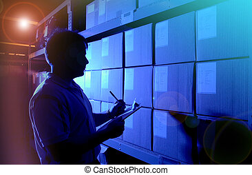 silhouette of person checking inventory in warehouse with lens flare