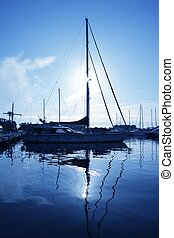 blue marina sunset boats with water reflection
