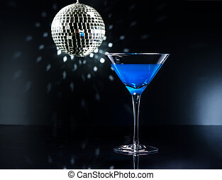 Blue Martini cocktail in an disco setting