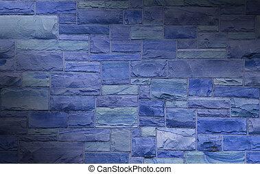Blue masonry wall lit diagonally