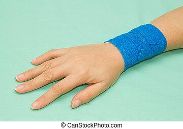 Blue medicine bandage on injury hand