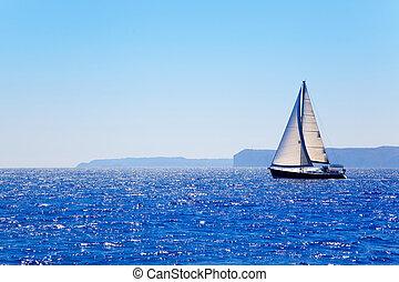 Blue Mediterranean sailboat sailing in perfect ocean at San ...