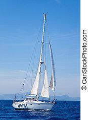 Blue Mediterranean sailboat sailing