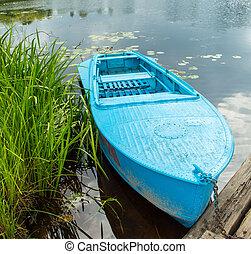 Blue metal rowing boat