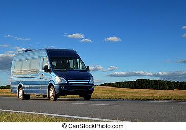 Blue minibus on highway - blue minibus transporting...