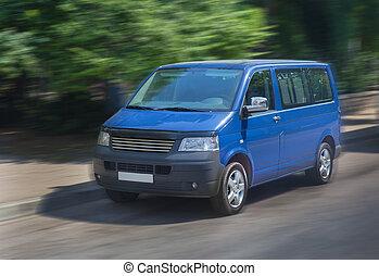 minivan moves on city street - blue minivan moves on city ...