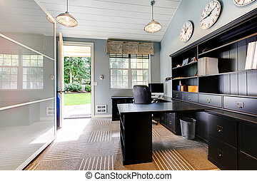 Blue modern home office interior design with dark brown furniture.