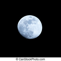 Blue moon on a black background at night