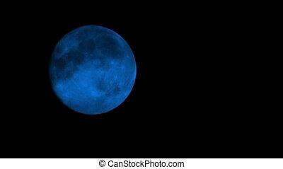 Blue Moon On Cloudy Night Closeup - Closeup of blue moon in...