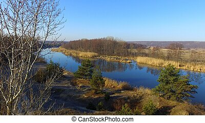 Blue morning river in early spring