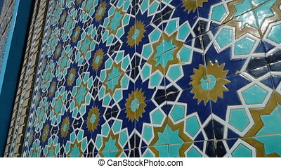 Blue mosaic on a wall - A panning, close up shot of a wall...