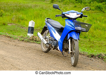 blue motorcycle on the country road