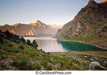 blue mountain lake at sunset
