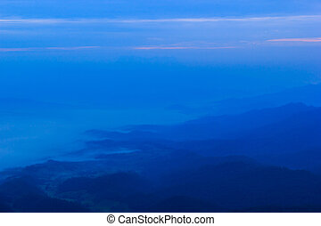 Blue mountain with blue sky and clouds background