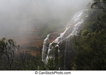 Blue Mountains and waterfall in heavy fog