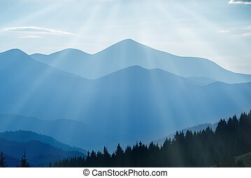 Blue mountains at sunset - Landscape with blue mountains and...