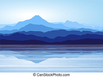 View of blue mountains with reflection in lake