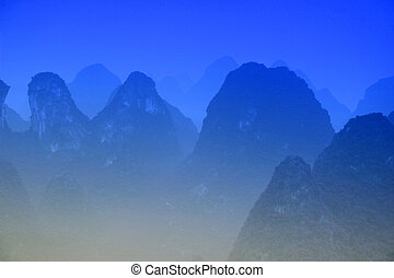 Blue Mt - Karst mountains at Li river near Yangshuo, Guangxi...
