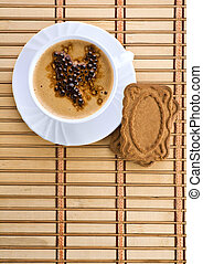 blue mug with espresso coffee with Cookies on a wum mat
