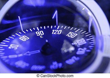 blue nautical compass closeup focus on east