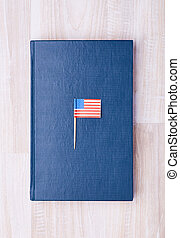 Blue notepad with flag on toothpick