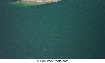 Blue ocean and rusty boat - A birds eye view shot of the...