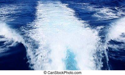 blue ocean sea with fast yacht boat wake foam of prop wash...