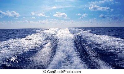 blue ocean sea with fast yacht boat wake foam of prop wash