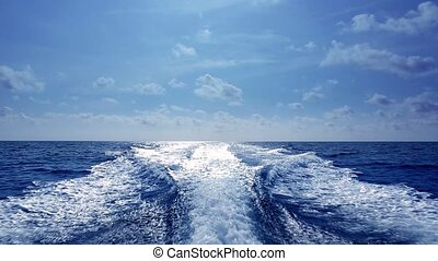 blue ocean sea with fast yacht boat wake foam of prop wash