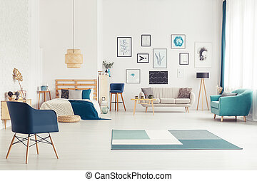 Blue open space interior - Blue armchair in open space...