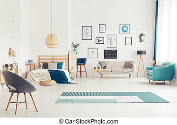 Blue open space interior - Blue armchair near beige sofa and...